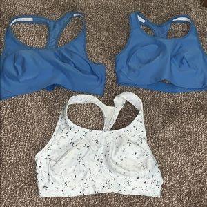 Three Avia sports bras